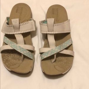 Merrell ivory and aqua sandals .